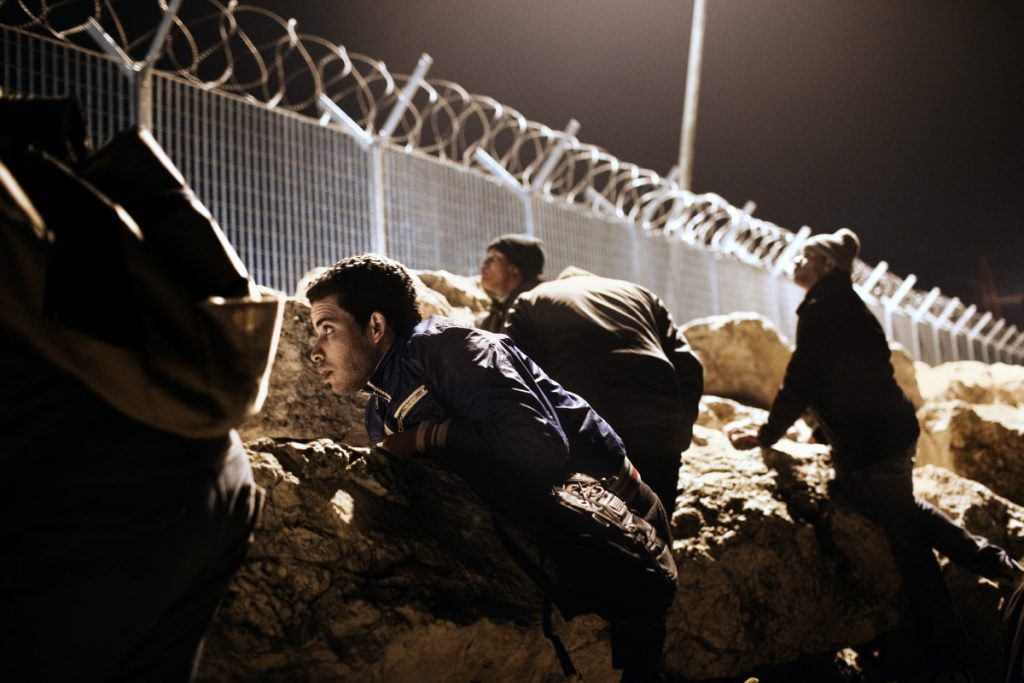 2012. Corinth. Greece. 17-year old Mohamed from Morocco and his friends hiding behind the rocks at the port during the night, waiting for the right moment to illegally board a ship to Italy. Many young migrants see other European countries as their only hope of a future, and attempt to leave Greece at the first possible moment, often in desperate ways, tolerating desperate conditions. In Greece, around 96% of requests for political asylum were refused in 2014, a modest improvement on 2012, when the refusal rate reached 99.5%. For this reason, young people must hide from the authorities, because having a Greek police record would mean the end of the dream of safe reception in Europe. According to European immigration regulations, if found by the Greek police, they must claim asylum in Greece, and they must not travel to or claim asylum in any other European country while their asylum application is being processed by Greece, which can take years. This is the story of young, unaccompanied migrants in Greece: young people who, every day, confront the difficulties of a country tormented by the economic crisis. Greece also refuses asylum requests more than any other country in Europe, reaching a 99.5% refusal rate in 2012. Many young migrants therefore see other European countries as their only hope of a future, and attempt to leave Greece at the first possible moment, often in desperate ways, tolerating desperate conditions.